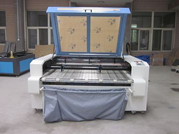 China Laser Fabric Cutter CO2 Laser Cutting Engraving Machine , Laser Power 100W supplier