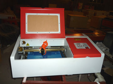 China Desktop Laser Engraver Co2 Laser Engraving And Cutting Machine For Carving Chapter And Artistic Works supplier
